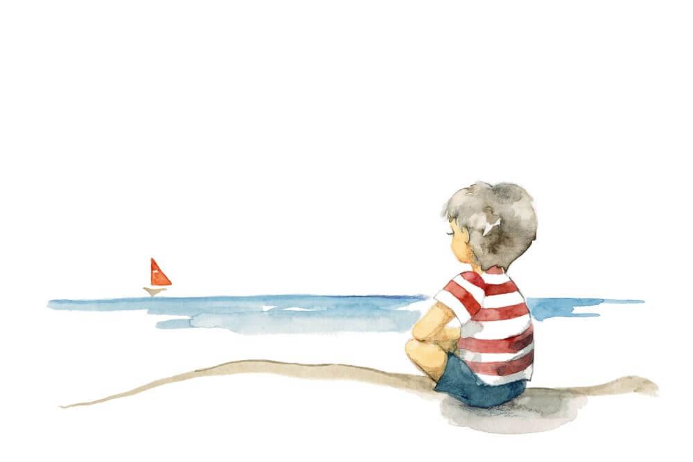 boy watching sailboat from shore
